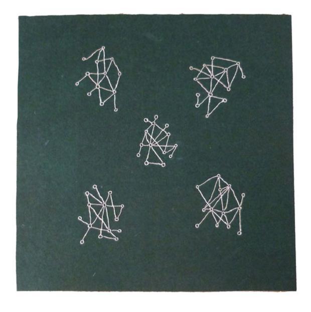 Luciano Tittarelli - Anni 10 - filo-metallico-argento-su-feltro-quadrato-eseguito-con-giovanna-2010